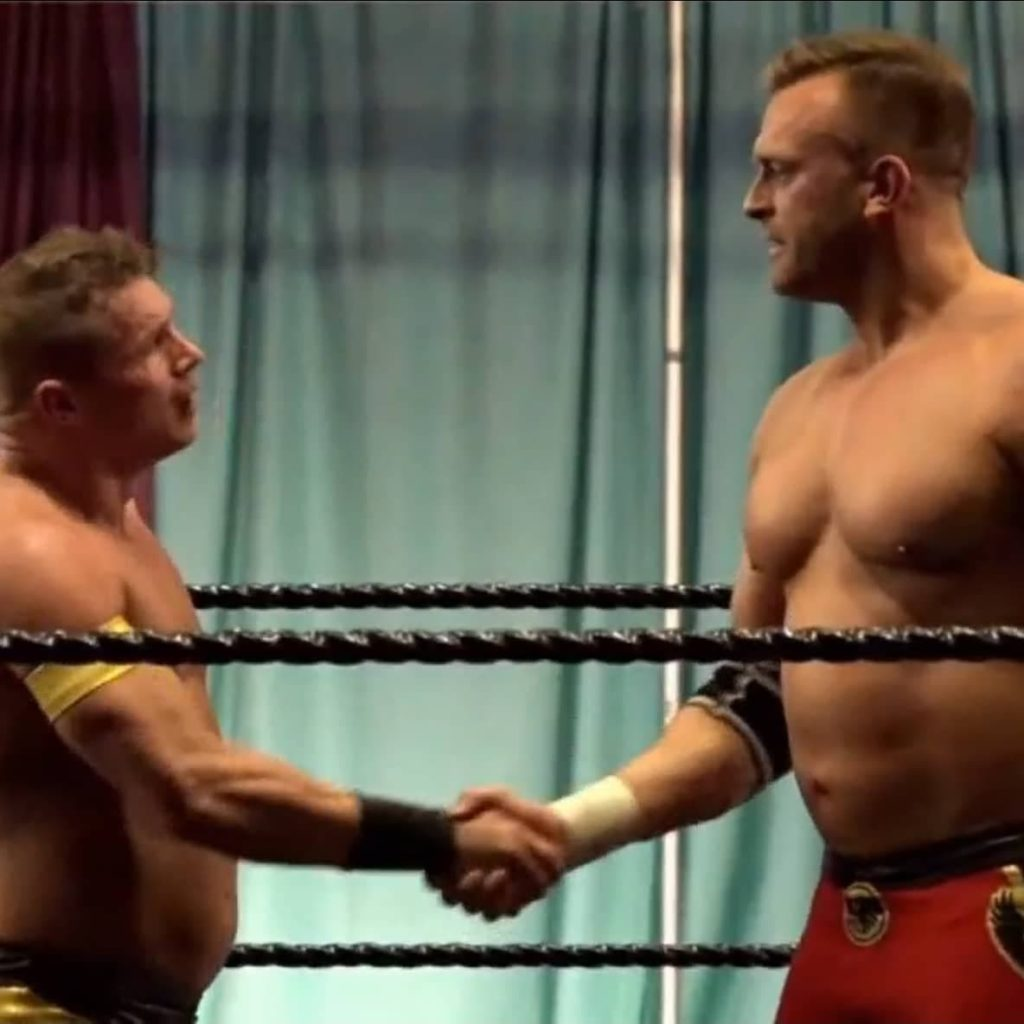 Jaysin Strife shakes Nick Aldis hand after losing to the NWA Worlds Heavyweight Champion